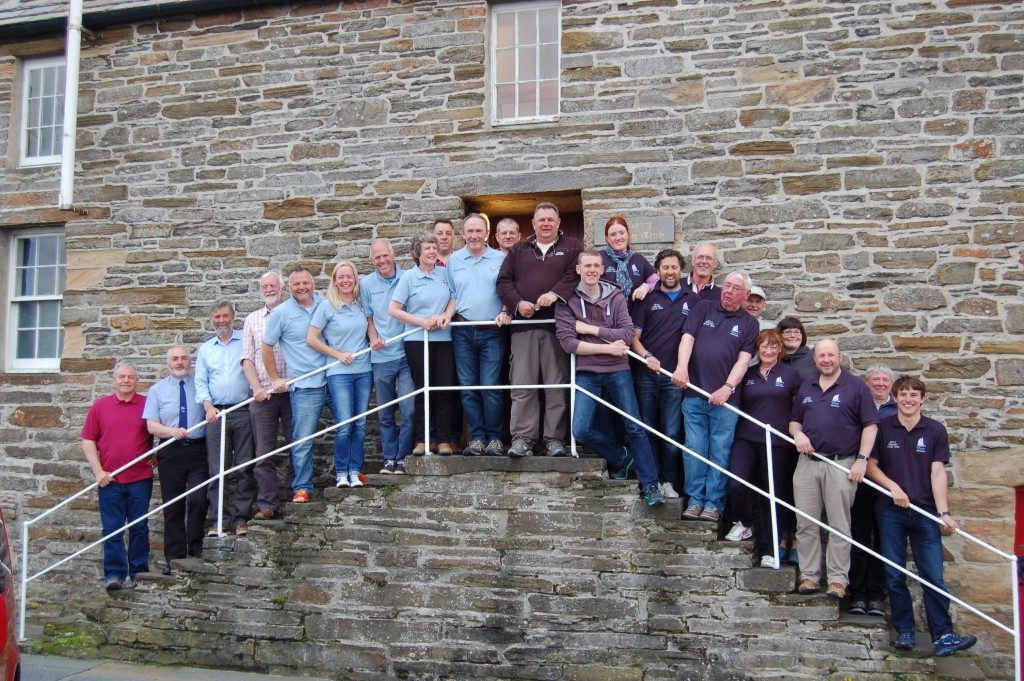 Crews and local organisers on the steps of Orkney Sailing Club after the prize giving
