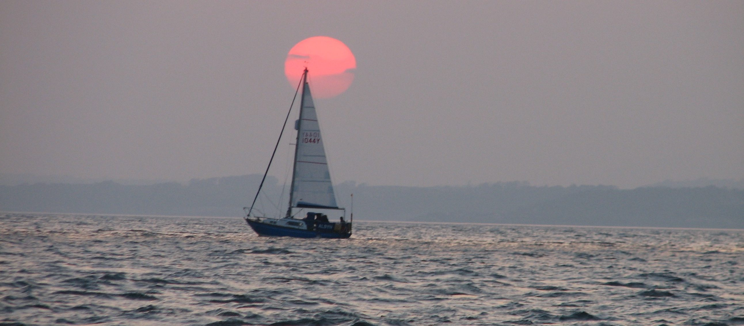 Sailing into the sunset... photo by Adrian Shield